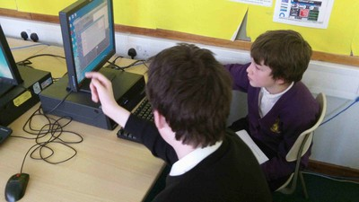 S3 Pupils teaching P7s at St Vincent's how to use Scratch